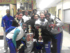 """The 15U Sensational Sophs pose with Coach """"J"""" after winning Charm City Championship"""