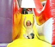 child_on_yellow_slide__180x1521