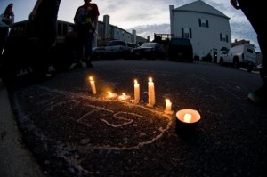 Friends, family and supporters gatehr for candelight vigil for Chris Jones (Photo: (C) Brian Brown)