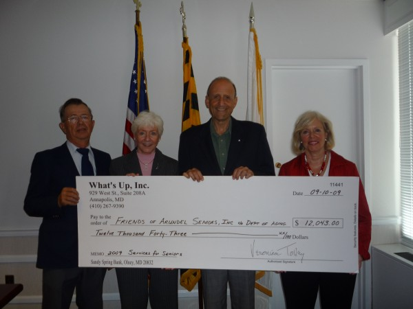 At a check presentation recently at the Arundel Center are, from left, Lloyd Lewis, president of Friends of Arundel Seniors Inc.; Dr. Carol Baker, director, Anne Arundel County Department of Aging and Disabilities; County Executive John R. Leopold; and Veronica Tovey, publisher, What's Up? Publishing Group Inc., which donated the $12,043 to the FoAS for safety equipment for senior citizens and adults with disabilities.