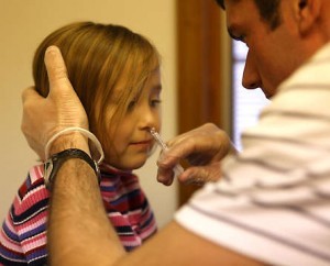 Child receives flu mist vaccine