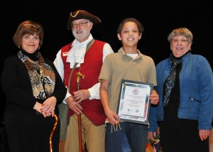 Squire Richard Hillman of Annapolis Tours by Watermark presents African American Heritage Award to Cameron Terrelonge, a student at Magothy River Middle School. (Courtesy Photo)