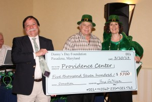 Chuck Coble receives the check for $5700 in grant funds from the Danny's Day Foundation for the purchase of two SMART boards for Providence Center sites. (Courtesy Photo)