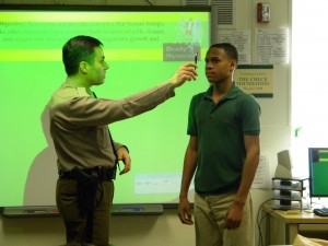 Summit 7th grader, Marcus Wade of Cheltenham, MD demonstrates the Horizontal Gaze Nystagmus sobriety test. (Courtesy Photo)