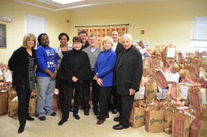 L to R Pam Siemer, Development Director, Light House Marcus Grant, Kitchen and Pantry Manager, Light House Michele Marshall, Associate Development Director, Light House Kitty and John Van de Kamp, she is Pres. of the St Vincent de Paul Society conference (John is her husband), Sam Davies, Volunteer Coordinator for the Food Drive, Elaine Larison, St. Mary's Food Drive Coodinator, Deacon Leroy Moore and Father Kevin Milton.