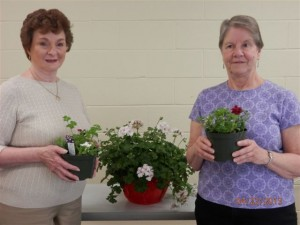 Pictured  are center members and 'Hearts of Gold FUNdraisers' team members Shirley Callahan, Edgewater, on left, and Peggy Barba, Gambrills, with a sampling of the plants that will be available on the sale days