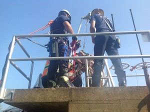 Rescue crews work to free a water plant employee trapped in a 22' pit.
