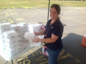 Lisa Lima of the Annapolis Salvation Army prepares boxed lunches at the POD site.