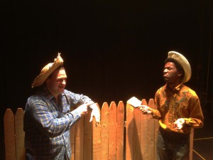 Erik W. Alexis of Millersville, left, as Huckberry Finn appears unconvinced by John Patterson as Tom Sawyer that white-washing the fence is something he would enjoy in one of the book's signature scenes.