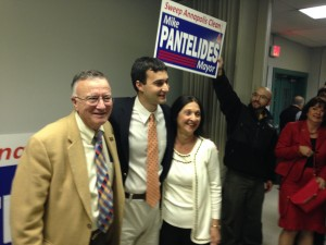 Mayor-Elect Michael Pantelides is flanked by his parents after the results of the mayoral race were announced