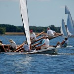 Watch CBMM log canoe races from the Winnie Estelle