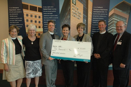 From left to right:  Rev. Jane Hague, assistant priest, St. Margaret's; Issy Winn, chair, St. Margaret's Grants Committee; Rev. Peter Mayer, rector, St. Margaret's; Sherry Perkins, COO; Kathleen Whittaker, manager, Patient Advocacy and Spiritual Care; Rev. Nick Szobota, chair, AAMC's Spiritual Advisory Committee; and Chaplain David G. Berg, CPE supervisor.