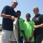 Annapolis Police go fishing with the kids