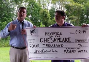 Michael S. McHale, President & CEO, Hospice of the Chesapeake, left, accepts $4,000 donation from Phil Franco of the Chamber of Ravens Nests.
