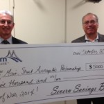 Severn Savings Bank presents $5K to support Tug-of-War