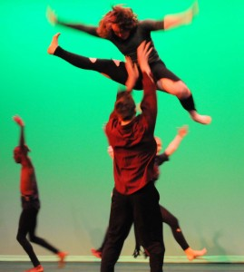 Members of the AACC Dance Company rehearse overhead movements in preparation for the Dec. 4-6 p.m. performances.