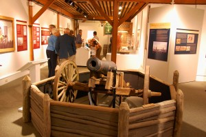 Exploring the impact of the War of 1812 on the people of the Chesapeake Bay with artifacts like Jacob Gibson's cannon, shown in the foreground, is the theme for CBMM's Navigating Freedom: The War of 1812 on the Chesapeake exhibition, which closes January 5. The cannon was used in the Battle of St Michaels in August, 1813. The Steamboat Building's first-floor Push and Pull: Life on Chesapeake Tugboats exhibition will also strike on January 5, so that CBMM can prepare for a major exhibition showcasing many of the most significant artifacts in the museum's 50-years of collecting.  A Broad Reach: 50 Years of Collecting is set to open during a private reception on Friday, May 22, 2015—in honor of the date the museum began in 1965. It opens to the public on Saturday, May 23, when CBMM will host a festival commemorating its 50th anniversary.