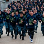 And they're off…Midshipmen running with Army-Navy game ball