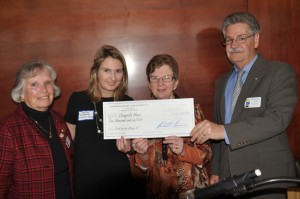 At the presentation of the $10,000 grant are, from left, Mimi Jones, Annapolis Rotary Club marketing director; Kristin McMahon, Chrysalis House development director; Terry Berg, Chrysalis House board president; and Marshall Larner, club president. The grant was made by the Rotary Club of Annapolis Foundation. (Photo by Michael Datch  )