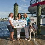 Watermark presents check to SPCA and announced Dogtoberfest Cruise