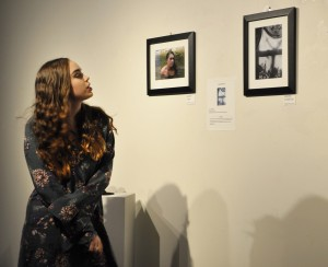"Melinda R. Myers of Severna Park stands near her black-and-white photography, ""Inside Out."""
