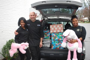 Chef Zachary Pope, shown here with Blackwall employees Randi Shultz and Jaleesa Johnson (manager), prepared and delivered holiday meals and gifts to ten Annapolis families in need on Christmas Eve.
