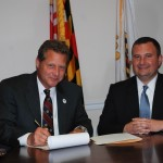 Schuh signs legislation assuring hotel safety and health