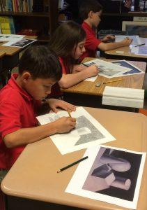 Fifth graders Gabriel Crane (Annapolis), Emily Dize (Crownsville), and Lucas Schueckler (Glen Burnie) work on art projects