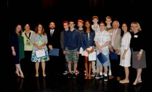 "From left, Hospice of the Chesapeake Volunteer Services Coordinator Kendall Sofia; Hospice of the Chesapeake Foundation Board member Susan Walker; Annapolis High School Performing and Visual Arts Department Chair Caroline Van Sicklin; PVA film teacher Leo Hylan, PVA students Campbell Jones, Wayne Degen, Jackson Snyder, Jaizani ""Zani"" Wilson, Aidan Mead, Jacob Benton and Liam Wagner; Sen. John C. Astle; and Diane Sancilio, Hospice of the Chesapeake Director of Volunteer Services and Melody Stried, Hospice of the Chesapeake Chief Operating Officer.  Photo by Elyzabeth Marcussen, Hospice of the Chesapeake"