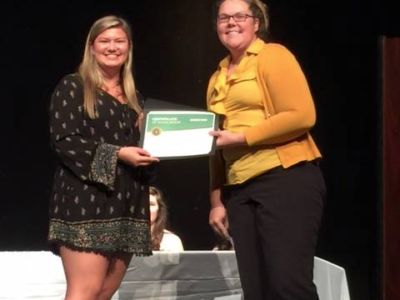 Local grad receives $1000 from Blades of Green Scholarship