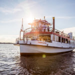 Watermark hosts Warrior Sailing Program for private dinner cruise on Harbor Queen