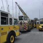 Fire crews rescue unconscious man from hold of boat in drydock
