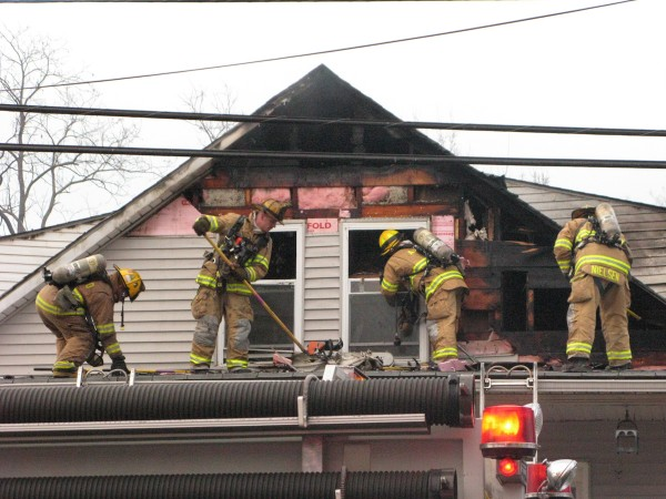 AA County Firefighters clean up after fire in Ferndale on March 19, 2009. (Photo Courtesy: Baltimore Breaking News/Baltimore Sun by John Milleker, Jr)