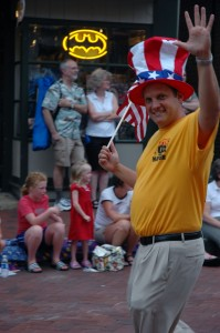Independent candidate for Mayor, Chris Fox waves to the crowd in the 4th of July Parade.