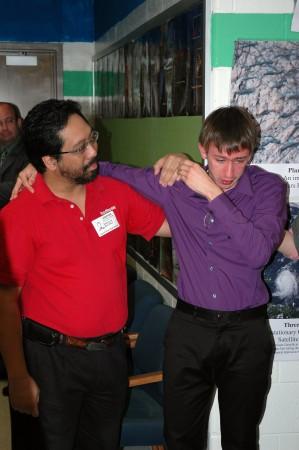 Taylor receives congratulations from David Cruz, his robotics mentor.