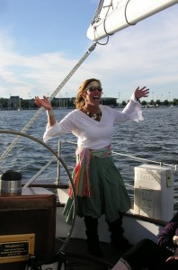 Captain Jenn takes the helm of the schooner Woodwind