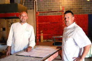 Chef Zachary Pope and Jason MacWilliams of Roundz look over plans the Roundz Gourmet Market space.