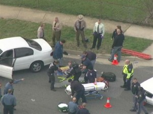 Suspect in high-speed chase is loaded onto stretcher after being shot by police. (Photo: Courtesy, WBAL-TV)