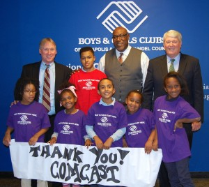 """Chris Comer, Comcast director of government and community affairs, Reginald Broddie, chief professional officer of the Boys & Girls Clubs of Annapolis & Anne Arundel County and Mike Busch, Speaker of House of Delegates, are joined by Boys & Girls Clubs of Annapolis & Anne Arundel County members Christian Jones (in red) and (left to right) Kaliah Ford, Tae' Fisher, Aaron LeBlanc, Madison Carey and Amaya Weston.  Comcast recently presented a $20,000 Comcast Foundation Grant to the Boys & Girls Clubs that will be used to support its """"Club Tech"""" digital literacy program. (Courtesy Photo)"""