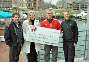 From left: Annapolis Triathlon Club Board Member J. Jeremy Parks, ATC President Ron Bowman and ATC Board Member Steve Ackerson present CBT Communications Director Molly Alton Mullins with a $3,000 donation to help restore the Chesapeake Bay.