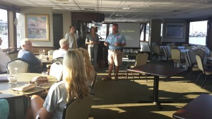 Captain Dean Scarborough introduces Doctors Krista Buckley, DO and Christina Ambro, MD to speak on skin health at Watermark's July Captain's Meeting. (Courtesy Photo)