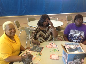 """""""Refugees"""" (L-R) Muriel Hicks, Patricia Lamb and Barbara Prather play bingo in the Pip Moyer shelter."""