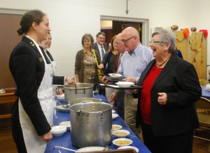 "Midshipman Chole Stapleton of the US Naval Academy women's basketball team, shares soup and a laugh with Carole Burchette of Annapolis at Heritage Baptist's 8th Annual SOUPer Bowl Lunch fundraiser for the Light House Shelter."" – Photo by Lea Hurt"