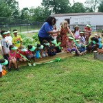 Agencies, community partner on Hilltop Elementary School community garden