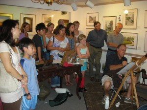 Stewart White, demonstrating painting an oil portrait at a previous year's Annapolis Art Walk.
