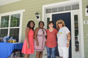 (From left to right) Daughter Mikell Green, homeowner Sherri Green, AmeriCorps member Jaclyn Tekiela, and Family Services staff Krista Stubbs at the Edgewater Dedication Ceremony
