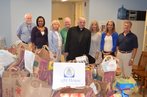 L to R Ed Cassidy, Light House Board, Michele Marshall, Light House, Elaine Larison, St Mary's Food Drive Coordinator, Dick Darcy, Light House Board,  Father Milton, St Mary's Parish, Pam Siemer, Director of Development Light House, Carol Drum, Light House, Sam Davies, Light House Volunteer