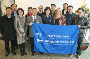 AACC President Dr. Dawn Lindsay, third from right, and Tian Yuan of the China Education Association for International Exchange, second from left, pose with some members of a Chinese delegation who visited AACC earlier in December to learn about the college's organization, governance system and partnerships with public schools, other colleges, government and businesses.