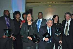 A packed house applauded these 10 awardees whose deeds, words and actions have helped to keep the legacy of Martin Luther King Jr. alive. They are (from left) Carl Owens, Rev. Dr. Carletta D. Allen, Ramocille Solenza Cooper Johnson, Alderwoman Rhonda Pindell-Charles, Bishop Douglas Miles, Jeffrey S. Blum, Miriam Stanicic, Community Relations Director of the United States Naval Academy and Howard Zeiderman (not pictured- Monzy Faulkner Jr. and Dr. Larry W. Blum).