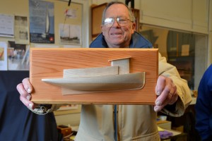 CBMM Model Guild President and volunteer Bob Mason holds an example of the half-hull model that will be made during a March 28 & 29 weekend workshop for participants 12 years of age and older. The beginner's workshop includes instruction on carving a solid half model of the historic Chesapeake Bay tugboat Delaware. This model is band-sawed from a two-tone wood block and carved to the rounded shape of the Delaware's hull. The cabin and pilot house are cut from the same pieces. The pieces are then shaped and sanded to a fine finish and then mounted on a baseboard to form a wall display piece that goes home with participants at the end of the workshop. To register or for more information, email aspeight@cbmm.org or call 410-756-2916.